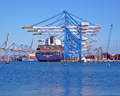 ocean container ship in port with cranes